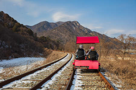 Activity trolley tram running on railway track in winter