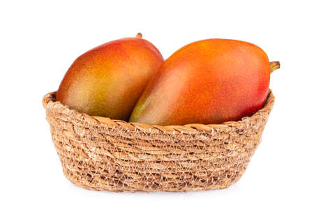wicker basket of mango isolated on white background 版權商用圖片