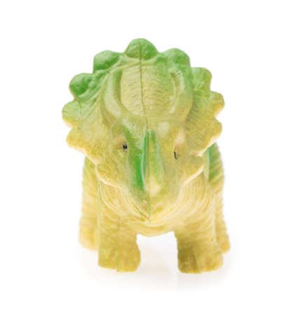 triceratops made out of plastic. dinosaur toy isolated on white background