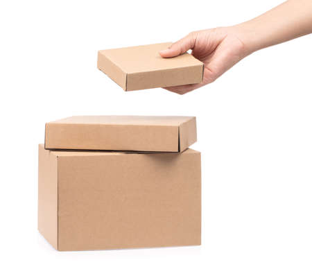 hand holding boxes stacked on white background.