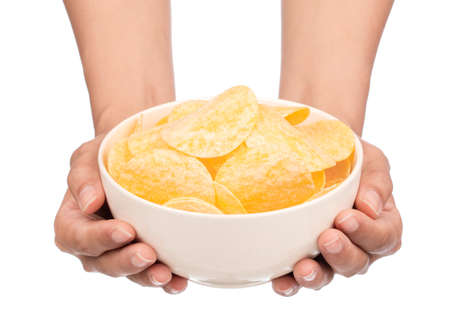 hand holding Potato chips on bowl isolated on white background