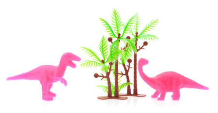 Tyrannosaur Rex and Apatosaurus made out of plastic. dinosaur toy isolated on white background Stock Photo