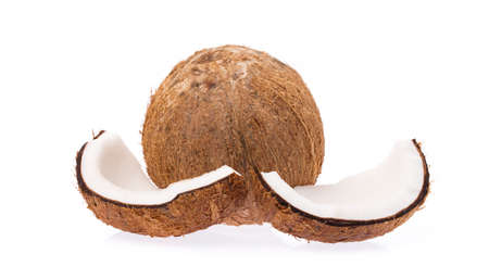 Old brown organic coconut fruit copra broken into pieces and stacked on white background Reklamní fotografie