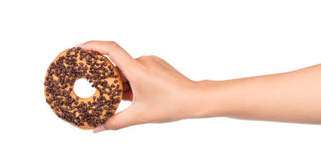 hand holding Delicious donut with chocolate isolated on white background.