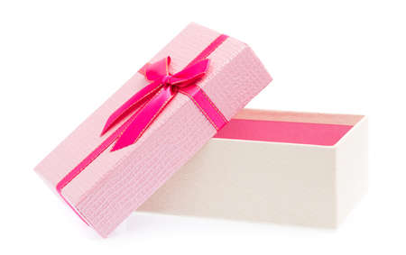Pink gift box with ribbon isolated on white background. Stock Photo