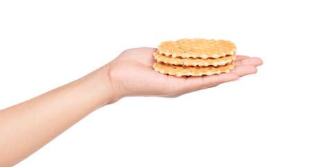 hand holding waffle isolated on white background