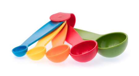 colorful measuring spoons isolated on white background