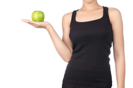 Young slim woman holding green apple. Isolated on white background. Concept of healthy food and the control of excess weight. Imagens
