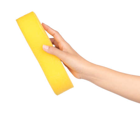 Hand holding yellow Sponge isolated on white background 免版税图像