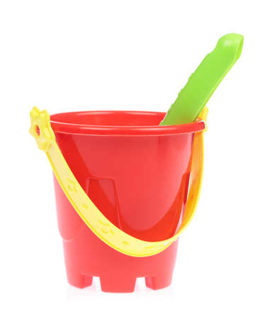 Toy plastic bucket with spade isolated on white background