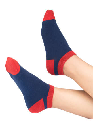 woman wearing blue socks with her feet isolated on white background 免版税图像