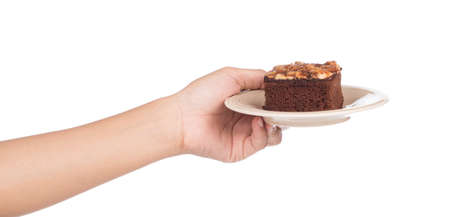hand holding Brownie almond on dish isolated on white background
