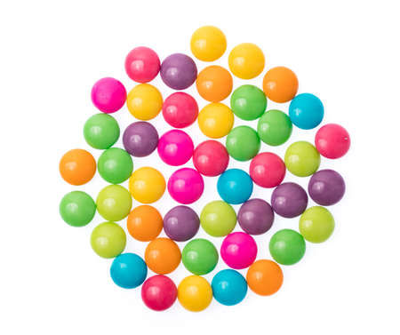 Close up of a pile of colorful chocolate coated candy isolated on white background Stok Fotoğraf