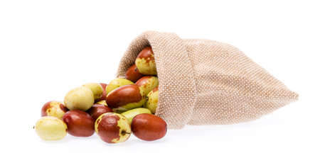 Textile-burlap sack of chinese jujube isolated on white background
