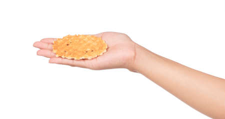 hand holding waffle isolated on white background