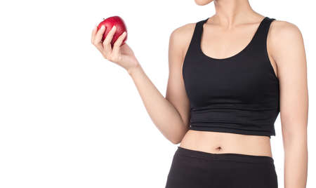 Young slim woman holding red apple. Isolated on white background. Concept of healthy food and the control of excess weight. Imagens