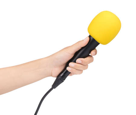 hand holding a microphone with sponge on head isolated on white background.