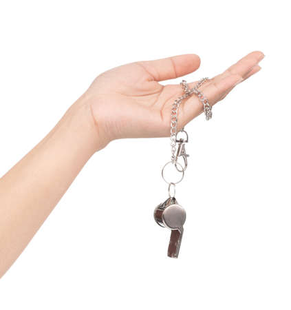 hand holding metal whistle isolated on white background