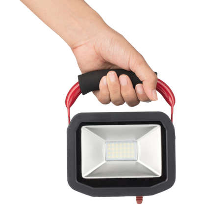 Hand holding Small LED sport light for solar energy isolated on white background. Фото со стока