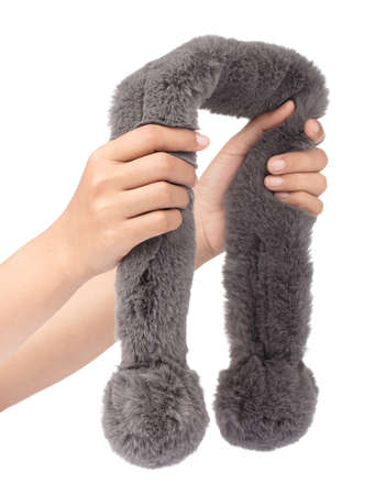 hand holding Grey fur scarf isolated on white background