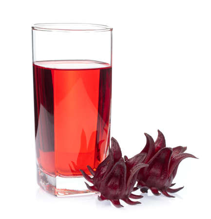 Hibiscus sabdariffa flower juice in glass isolated on white background. Imagens