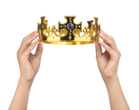 Hand holding crown golden isolated on a white background