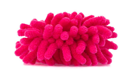 Pink duster microfiber for cleaning the house isolated on white background