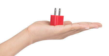 Hand holding Red of USB power plug adaptor isolated on white background