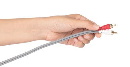 Hand holding Mono Plug Audio Connector isolated on white background