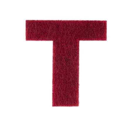 Alphabet T is made of felt isolated on white background.