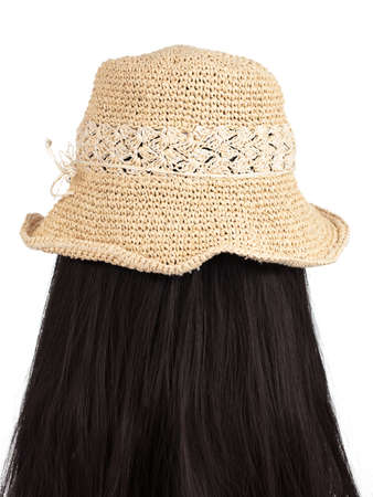Summer hat on mannequin head isolated on white background