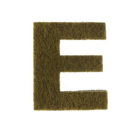 Alphabet E is made of felt isolated on white background.