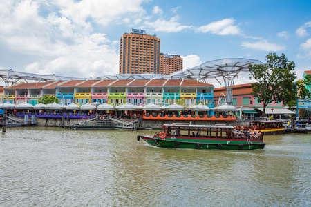 SINGAPORE - FEBRUARY 19, 2017:Tourist boat on the Singapore river along the Clarke Quay