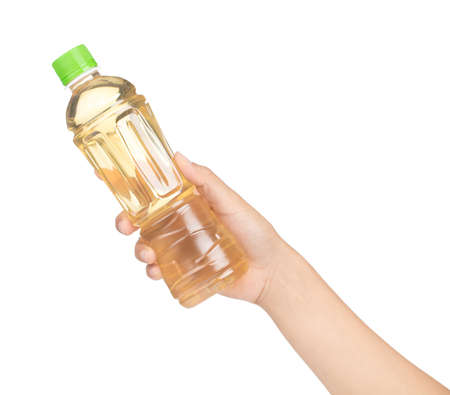 hand holding bottle of tea isolated on white background