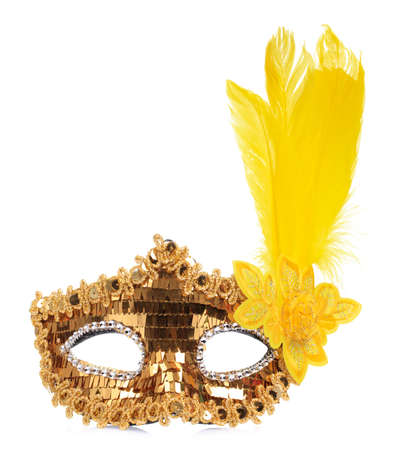 Golden carnival mask with yellow feathers isolated on white background