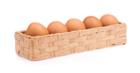 chicken eggs in basket isolated on white background
