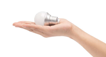 hand holding an incandescent bulb isolated on white background.