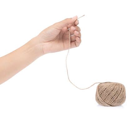 hand holding wool yarn isolated on a white background. Stock Photo