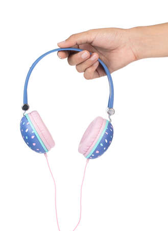 Hand holding Blue headphones with pink pastel color isolated on white background