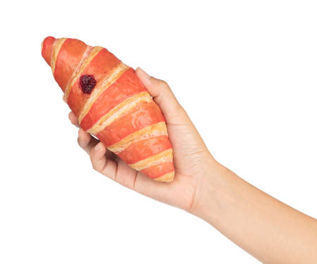 hand holding Croissant with strawberry jam on wood dish isolated on white background. 版權商用圖片