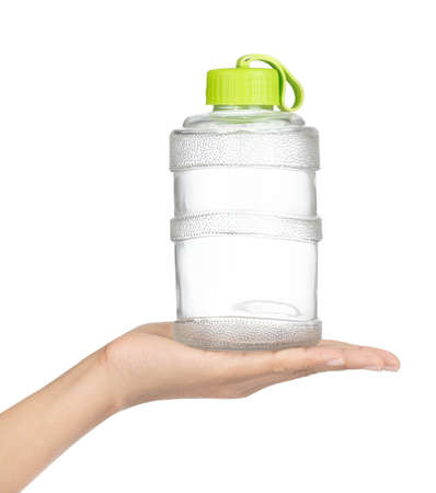 Hand holding Water bottle isolated on white background