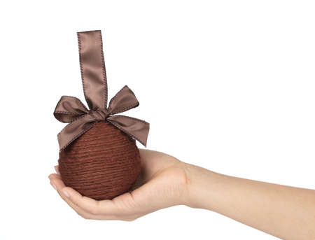 Hand holding Ball of yarn with ribbon Isolated on White background Imagens - 124889591