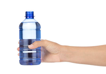Hand holding a bottle of water isolated on white background Imagens - 124889596