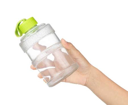 Hand holding Water bottle isolated on white background Imagens - 124889607