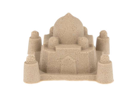 sand sculpture of castle isolated on a white background