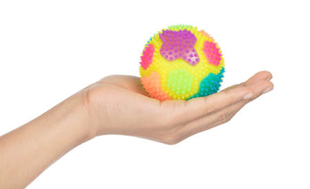 Hand holding Colorful Massage Rubber Ball with Spikes Isolated on White background Imagens - 124889639