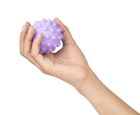 Hand holding Rubber ball toy isolated on white background Stock Photo