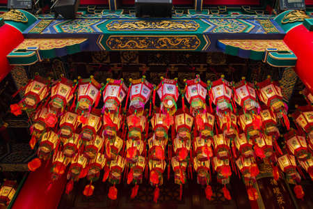 Hong Kong - March 20, 2016:Red lanterns hang in rows in Wong Tai Sin Temple. Editorial