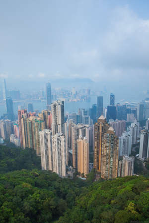 Hong Kong - March 19, 2016:Aerial view of Hong Kong in the day viewed from mountain top Imagens - 124911944