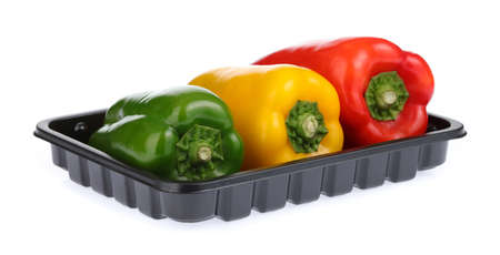 three bell peppers on Black Plastic food Tray isolated on white background